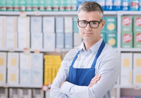 Photo for Confident smiling supermarket clerk posing at the shopping mall, retail job concept - Royalty Free Image
