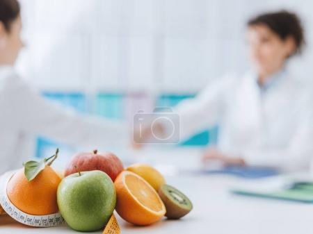 Professional nutritionist meeting a patient