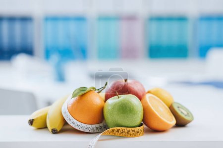 Fresh healthy fruits and tape measure