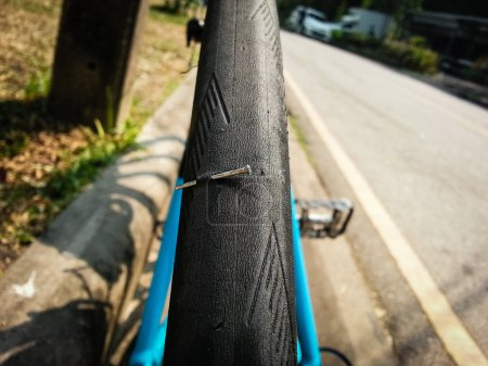 Photo for Close up of bicycle tires with stabbed nails - Royalty Free Image