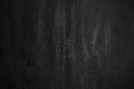 Photo pour Le mur de pierre béton texturé fond noir - image libre de droit