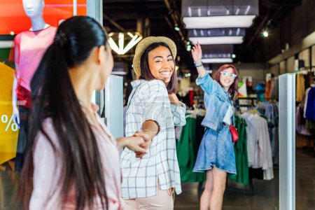 multicultural girls in shopping mall