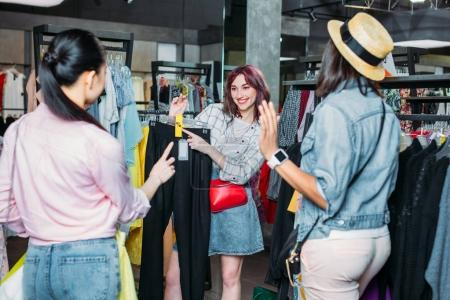 Photo for Multicultural hipster girls choosing clothes in boutique, fashion shopping girls concept - Royalty Free Image