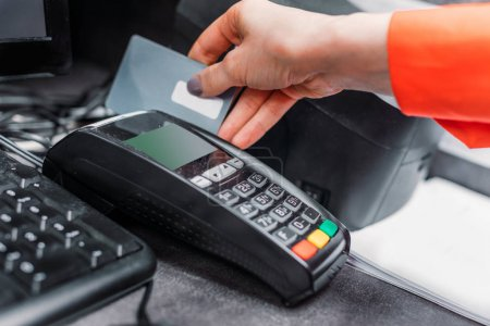 Person using payment terminal