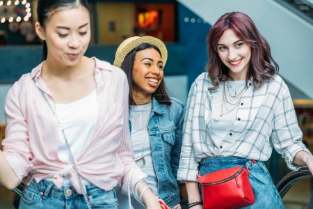 Photo for Happy young stylish women walking together in shopping mall, young girls shopping concept - Royalty Free Image