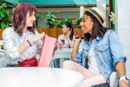 Young women in shopping mall