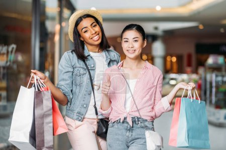 stylish friends shopping together