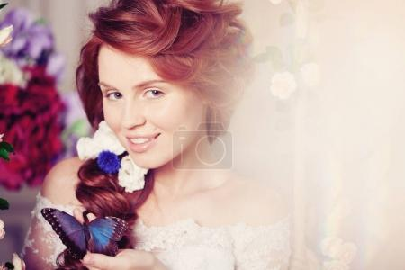 Beauty bride in a luxurious interior with flowers