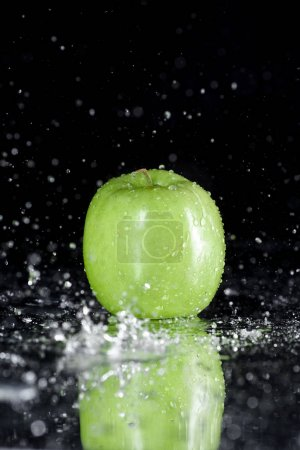 Green apple with drops