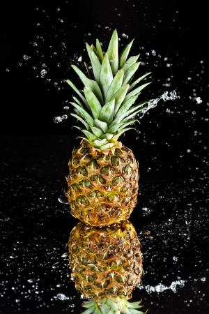 Photo for Close-up view of fresh ripe pineapple with water drops isolated on black - Royalty Free Image