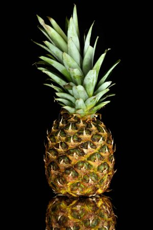 Photo for Close-up view of single fresh ripe pineapple isolated on black - Royalty Free Image