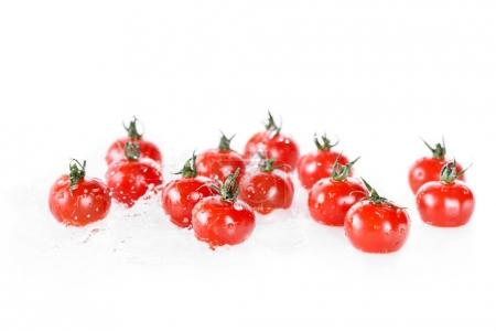 Photo for Heap of clean wet cherry tomatoes isolated on white, fresh vegetables on white - Royalty Free Image