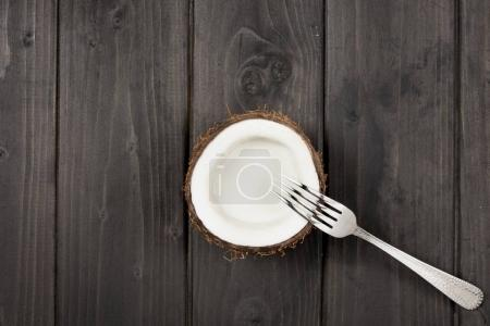coconut half and metal fork