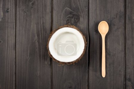 ripe coconut with milk and spoon