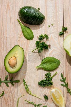 Sliced avocado and greens