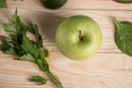 apple with parsley on wooden table