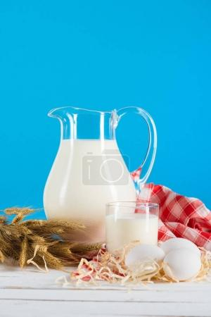 Fresh milk in glass and jug