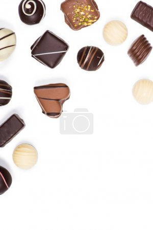Photo for Flat lay of assortment of sweet delicious chocolate candies isolated on white - Royalty Free Image