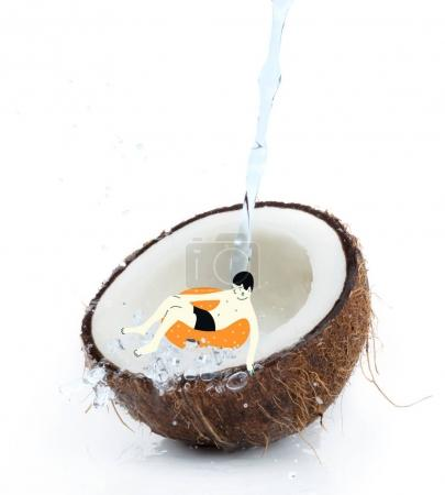 drawn man on float in tropical coconut half