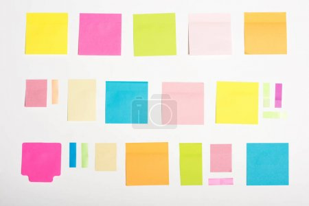 Photo for Top view of different empty colorful sticky notes isolated on white - Royalty Free Image