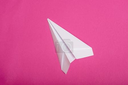 Photo for Top view of white paper plane isolated on pink - Royalty Free Image