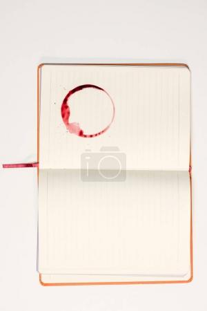 blank notebook with red wine stain