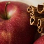 red apple and cinnamon sticks