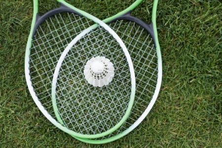 Shuttlecock on badminton rackets