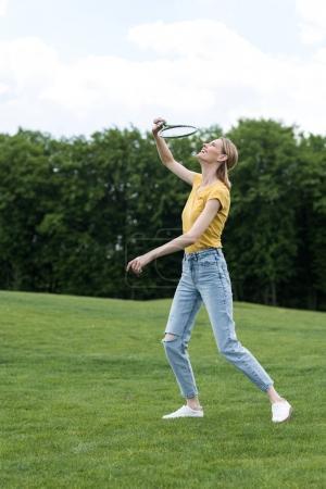 woman playing badminton