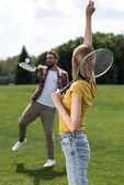 couple playing badminton