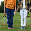 Cropped shot of siblings with badminton racquets h...