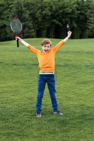 Boy with badminton racquet