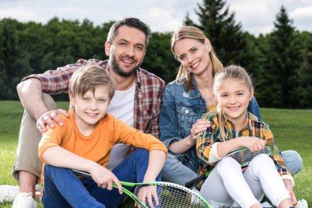 Happy family with badminton racquets
