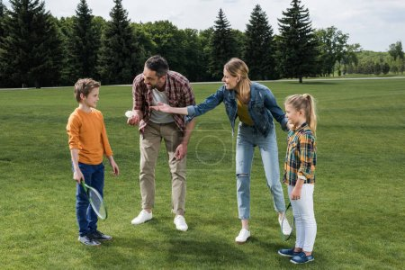 parents playing badminton with kids