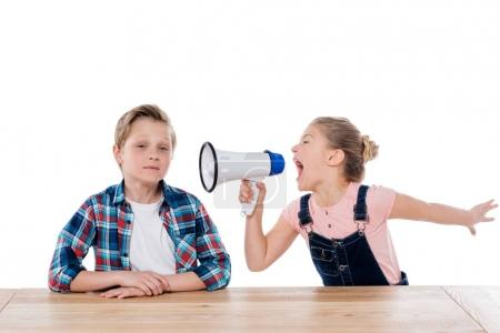 girl with megaphone yelling on her brother