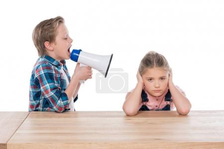 boy with megaphone yelling on his sister