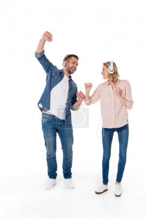 Couple listening music with headphones