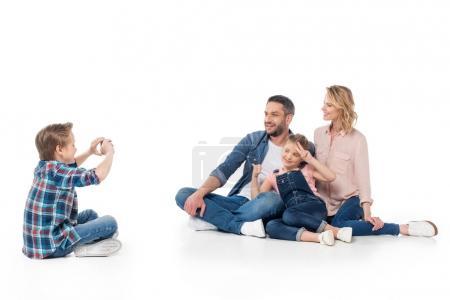 boy taking photo on his family