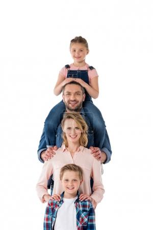 Photo for Smiling family posing together and looking at camera isolated on white - Royalty Free Image