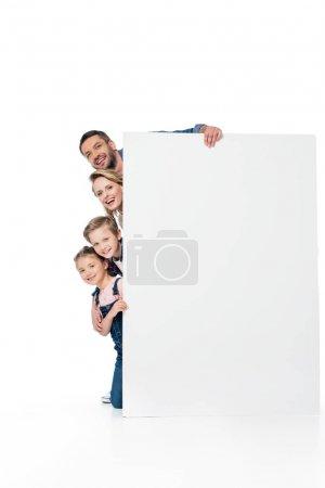 family holding blank banner