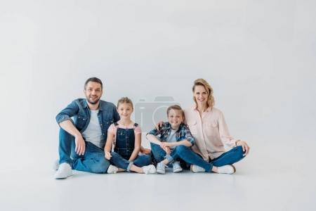 Smiling family looking at camera