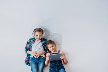 casual kids using digital devices