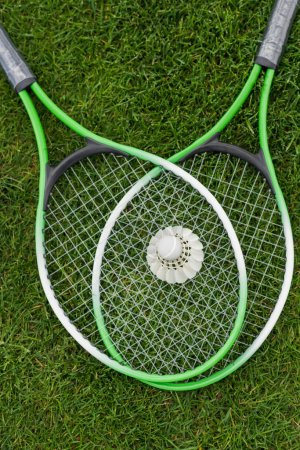 Shuttlecock on badminton rackets