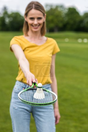 Photo for Close-up view of woman holding badminton racquet with shuttlecock on the top - Royalty Free Image