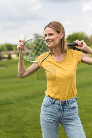 woman with badminton racquet