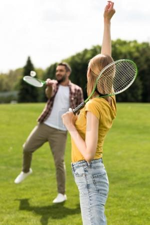 couple playing badminton