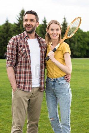 Couple with badminton racquet
