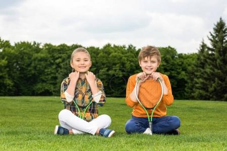 Kids with badminton racquets