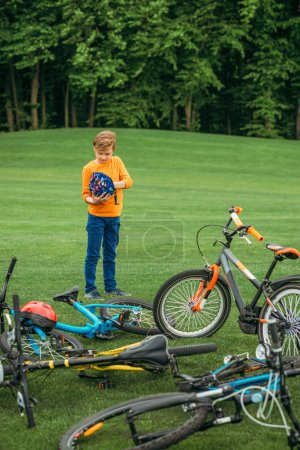 Boy standing near bicycles