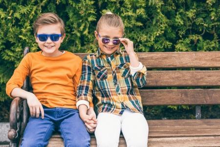 children in sunglasses at park